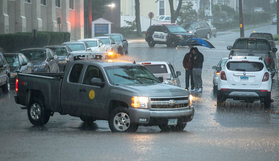 A city truck blocks flooded Pratt Street in Meriden, Tuesday, Sept. 25, 2018. Heavy rain Tuesday evening closed roads and flooded basements of local homes. Dave Zajac, Record-Journal