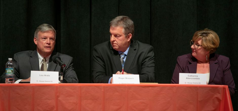 Republican Lou Arata, left, speaks during a debate with Libertarian Roger Misbach, center, and Rep. Catherine Abercrombie, D-Meriden at Washington Middle School sponsored by the Record-Journal, Midstate Chamber of Commerce, and Meriden Board of Education, Thursday, Oct. 18, 2018. Republican, Democratic and Libertarian candidates in three local races were sharply divided Thursday on the implementation of tolls, how to close a 4.5 billion deficit, and other issues. Dave Zajac, Record-Journal