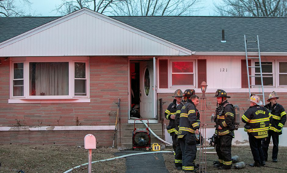 Meriden firefighters confer after putting out a fire at 121 Belvedere Dr. in Meriden, Mon., Jan. 7, 2019. There were no reports of injuries. Dave Zajac, Record-Journal