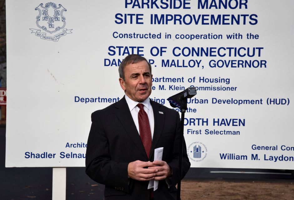 First Selectman Michael Freda commemorates new improvements to Parkside Manor Housing, 191 Pool Rd. in North Haven, on Monday, Dec. 17, 2018. The town recently completed exterior site improvements and replacement of the fire alarm system thanks to a grant from the U.S. Department of Housing and Urban Devleopment through the Small Cities Program. | Bailey Wright, Record-Journal