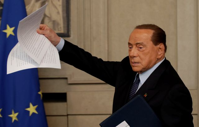 Forza Italia party leader Silvio Berlusconi shows the press his speech after meeting Italian President Sergio Mattarella, in Rome, Thursday, Aug. 22, 2019. President Sergio Mattarella continued receiving political leaders Thursday, to explore if a solid majority with staying power exists in Parliament for a new government that could win the required confidence vote. (AP Photo/Alessandra Tarantino)