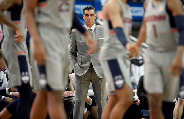 Villanova head coach Jay Wright watches the Connecticut starters walk onto the court during the first half of an NCAA college basketball game, Saturday, Jan. 20, 2018, in Hartford, Conn. (AP Photo/Jessica Hill)