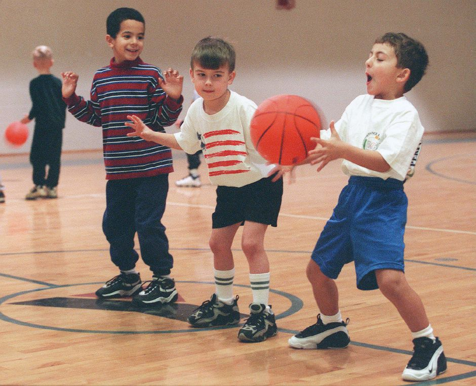 RJ file photo - Anthony Pellicano, 5, catches a pass during a drill at the Meriden YMCA Jan. 10, 1999. With him are Alexio Cardona, left, 6, and David Beigert, 5. All three boys are from Meriden.