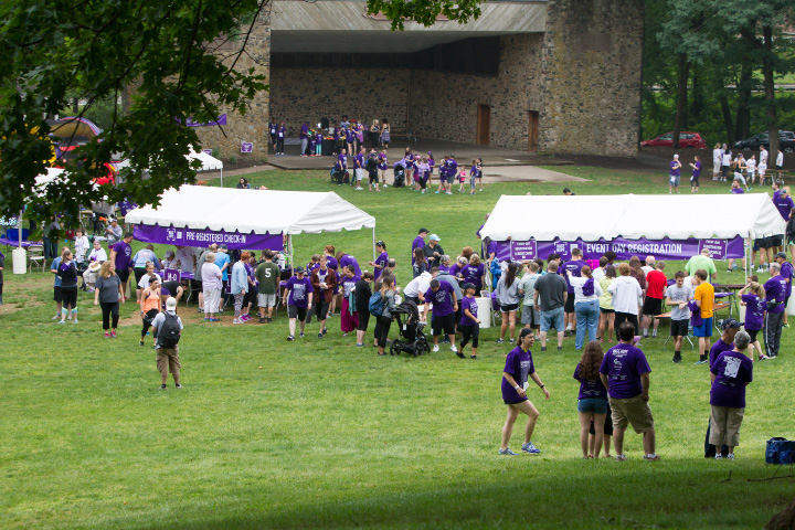 Participents fill the green in front of the Band Shell Saturday during the PurpleStride 5k and walk fundraiser for Pancreatic Cancer Action Network at Hubbard Park in Meriden Jun. 17, 2017 | Justin Weekes / For the Record-Journal