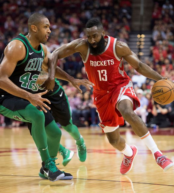 Houston Rockets guard James Harden (13) drives by Boston Celtics forward Al Horford (42) during the first half of an NBA basketball game Saturday, March 3, 2018, in Houston. (AP Photo/George Bridges)