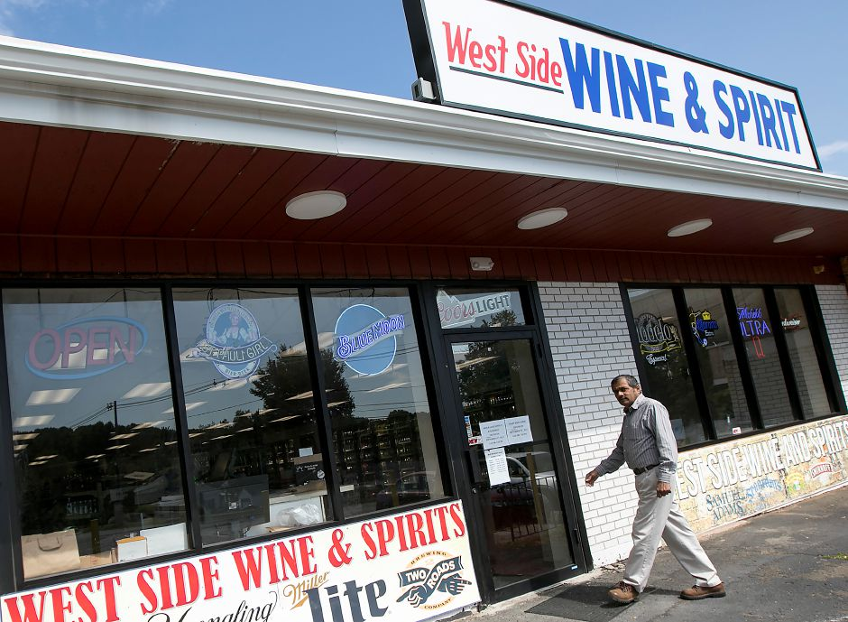 B.M. Patel, co-owner of West Side Wine and Spirits on Hope Hill Road in Wallingford, walks into the store, Wednesday, Sept. 13, 2017. The store recently opened at the corner of Hope Hill Road and Highland Avenue after about a year of renovations. Patel will also be opening Suburban Market grocery store next door in early 2018. | Dave Zajac, Record-Journal