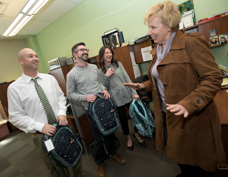 From left, social studies teachers Dan Lobner, Chad Cardillo and Debbie Banas  smile after receiving professional learning grants from Karen Webb, right, president of Fund for Teachers, at Maloney High School on Thursday.  Dave Zajac, Record-Journal