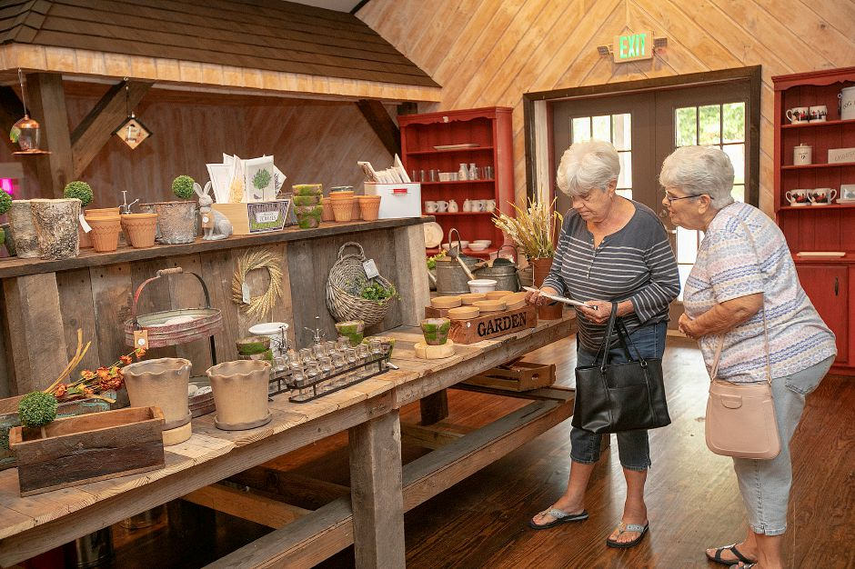 Phyllis Rubbo and her sister, Joanne Reinhard, right, of Cheshire, look over items Wednesday in the store at  Bishop Farm in Cheshire. The shop reopened last weekend. Dave Zajac, Record-Journal