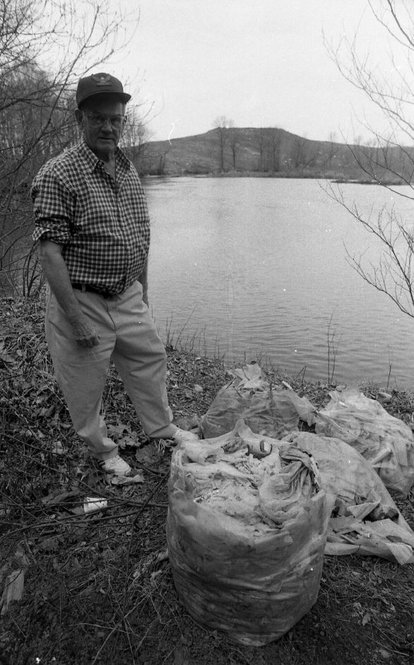 RJ file photo - Hanover Street resident Ted Hax is disgusted by the buildup of garbage on the shores of the Quinnipiac River across from the Meriden landfill, March 1989.