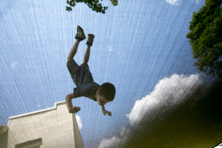 Kenai Plaskett, 7, of Southington, flips on a trampoline at his residence in Southington, Wednesday, June 28, 2017. Kenai