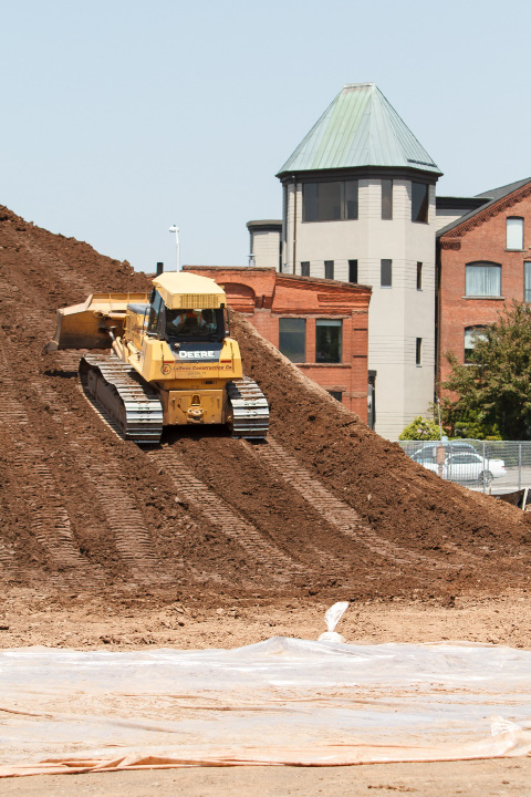 A LaRosa Constuction bulldozer moves screened dirt Tuesday in the northwest corner of the Hub project in Meriden.