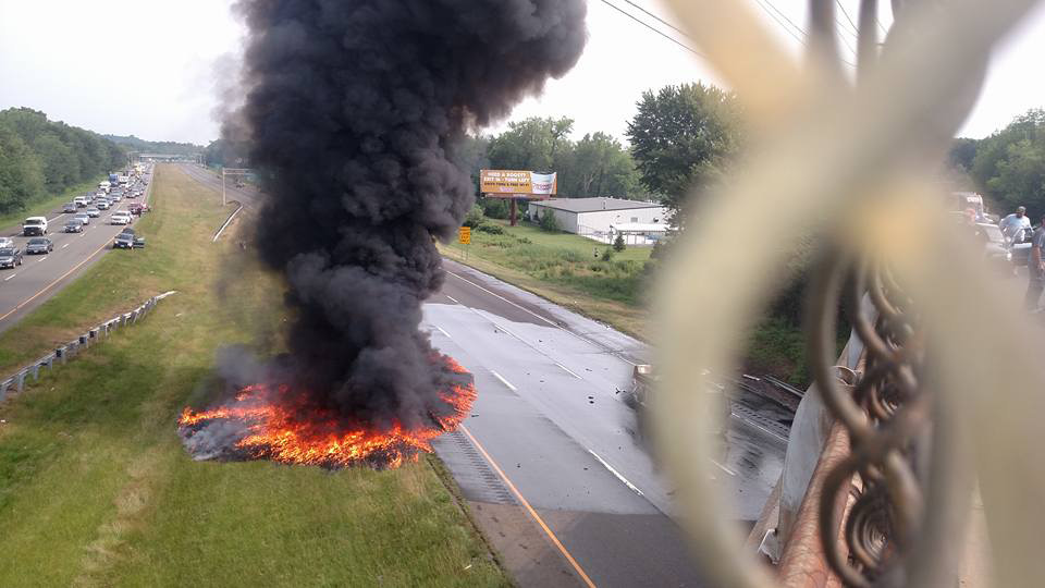 Fire and dark smoke can be seen following a fuel tanker crash on Interstate 91 South in Meriden, Monday, July 13, 2015. l Photo courtesy of Eric Sullivan