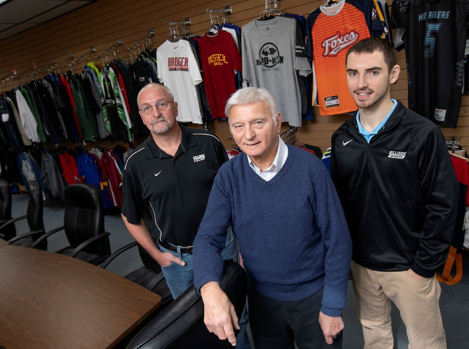Left to right, Michael Billings, Robert Billings and Anthony Melillo pose for a photo at Billings Sports, 706 E. Main St., Meriden, Mon., Nov. 11, 2019. Billings Sports celebrated its 50th anniversary two weeks ago. As part of their celebration, Billings agreed to reopen its front door to accomodate its Imprintz operation. Dave Zajac, Record-Journal