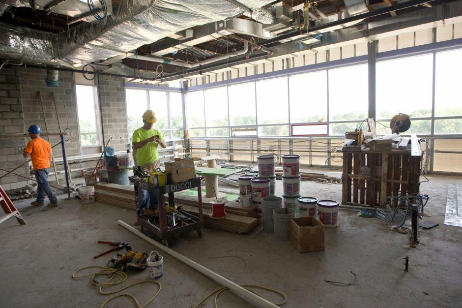 Crews work in a future science classroom in the new three-story section of Maloney High School, Wednesday, July 30, 2014. The science classrooms will include new furniture and science equipment. | Dave Zajac / Record-Journal