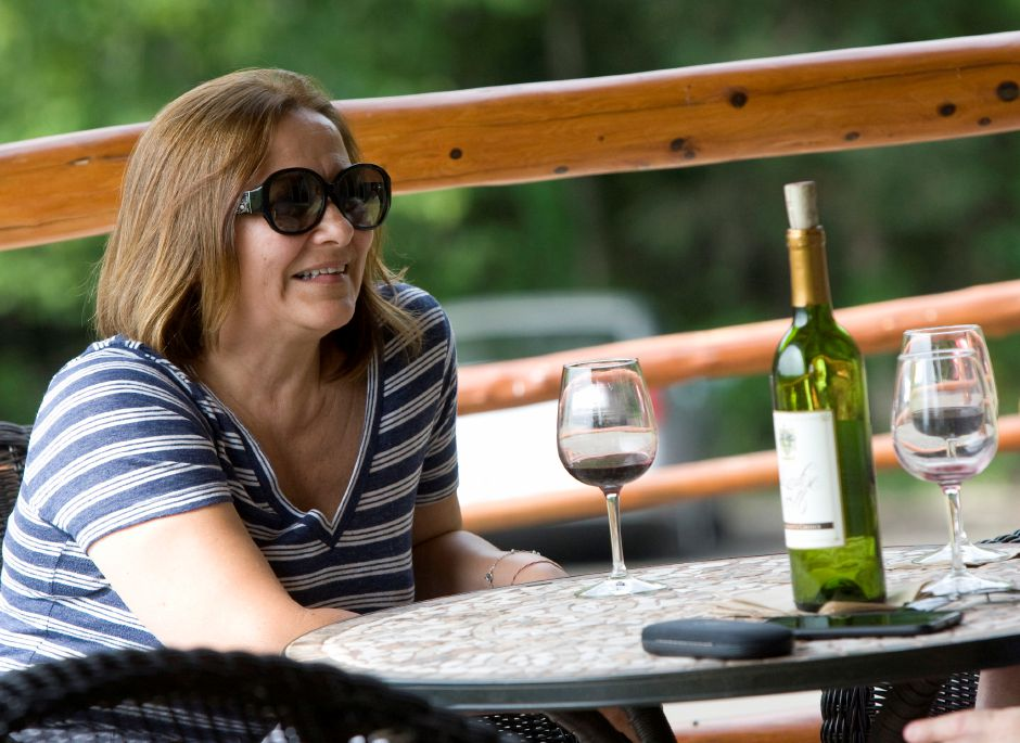 Lilliana Pochet, visiting from Costa Rica, enjoys a red wine with friends at Paradise Hills Vineyard & Winery in Wallingford, Thursday, June 25, 2015. | Dave Zajac / Record-Journal