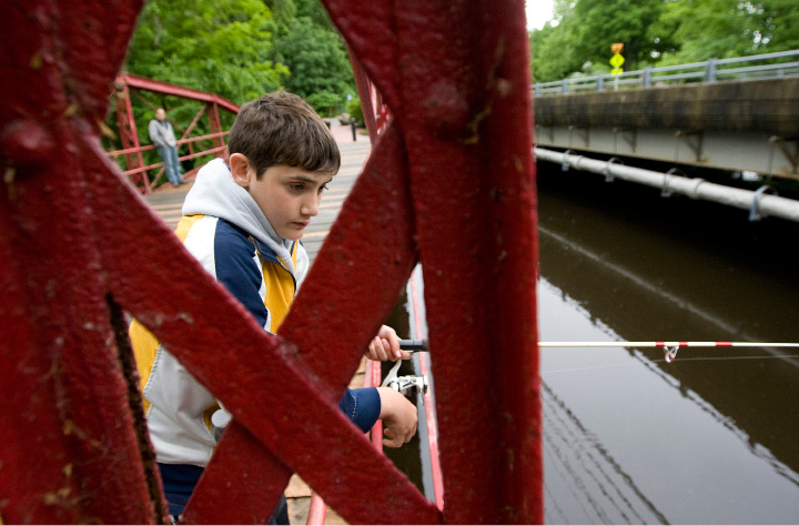Joey Tellerico, 13, of Southington, hopes for a bite while fishing the Quinnipiac River from Red Bridge in Meriden, Tuesday afternoon, June 2, 2015.    |  Dave Zajac / Record-Journal
