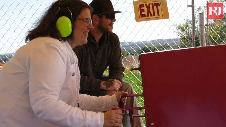 People try out Lyman Orchards' new apple cannons in Middlefield on Sept. 30, 2019. | Bailey Wright, Record-Journal