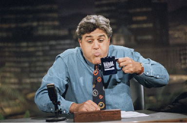 """Tonight Show"" host Jay Leno, taping a promotional spot, spits out his water after jokingly reacting to the news that David Letterman"