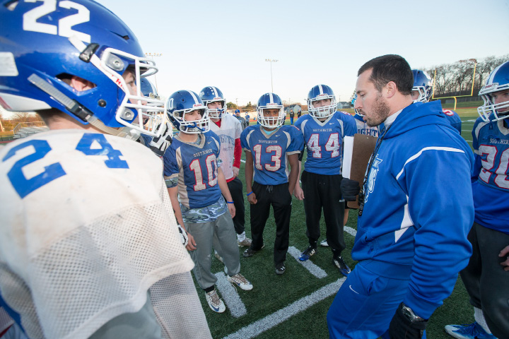 Southington head coach Mike Drury talks with his players at practice Monday as the Blue Knights prepared for tonight's CIAC Class LL playoff game with Norwich Free Academy at Fontana Field in Southington. | Justin Weekes / Special to the Record-Journal