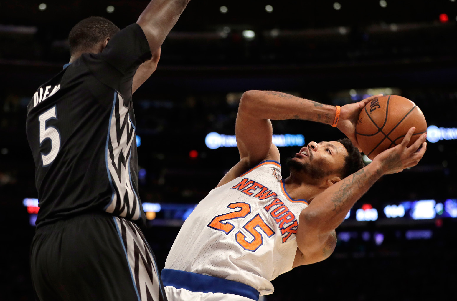 New York Knicks guard Derrick Rose (25) is fouled by Minnesota Timberwolves forward Gorgui Dieng (5) during the second half of an NBA basketball game at Madison Square Garden in New York, Friday, Dec. 2, 2016. (AP Photo/Julio Cortez)