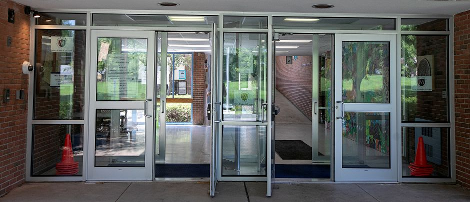 Entrance doors opened to vent smoke after a fire at Thomas Hooker Elementary School in Meriden, Friday, August 10, 2018. Dave Zajac, Record-Journal
