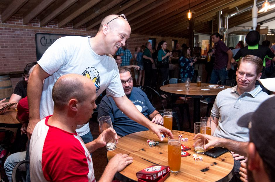 Kinsmen Brewing ranks fifth on TripAdvisor.com's list of things to do in Southington. In this file photo, Andy Geremia shows off his newly created card game Brew Dice at the CT Small Business Party on August 10, 2017. | Devin Leith-Yessian/Special to the Record-Journal