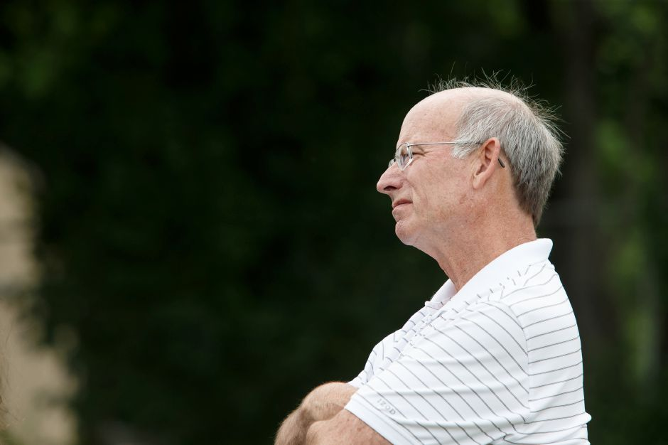 Colin Lavalette listens to students speeches one last time before fully retiring Friday during Lyman Hall High School