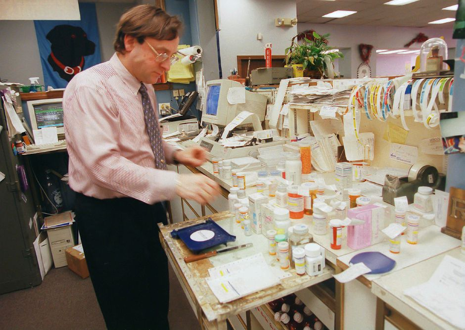 RJ file photo - Ronald Serafino prepares prescriptions at the Serafino Pharmacy in Southington, March 1999.