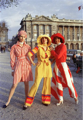 "Jean Patou presents in his summer 1972 ""ready to wear this Convicts"" style. From left to right are Marine Joel wears jersey skirt in red and white stripes, Veronique an ensemble pantaloon in yellow stripped rainbow jersey and Francoise a stripped red and white cotton jumper in Paris on October 21, 1971. (AP Photo/Lipchitz)"