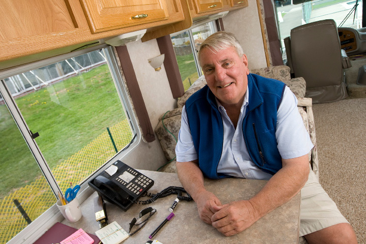 City Parks and Recreation Director Mark Zebora sits at his desk in a mobile trailer parked on the grounds of the Daffodil Festival at Hubbard Park in Meriden, Monday, April 25, 2016. For the entire festival weekend, and most of the week between event weekends, Zebora will be running operations from the mobile trailer.   |  Dave Zajac / Record-Journal