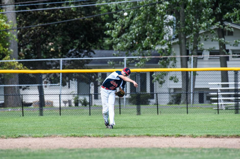 Rightfielder Ethan McDonough fields a fly ball against Stamford in the American Legion state championship game at Meridens Ceppa Field