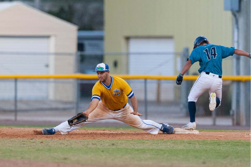 Cheshire's Mike Purcell, a senior first baseman at Rollins College, makes the stretch to nip an opposing batter by half-step.  The Xavier grad is among the leading hitters at the Division II college in Winter Park, Fla. | Jim Hogue photo, Courtesy of Rollins College