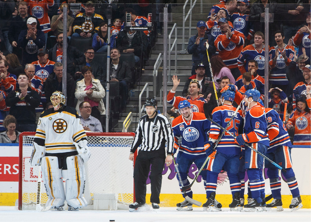 Edmonton Oilers celebrate a gaol against Boston Bruins goalie Tuukka Rask (40) during the first period of an NHL hockey game in Edmonton, Alberta, Thursday, March 16, 2017. (Jason Franson/The Canadian Press via AP)