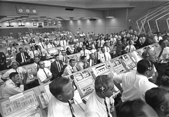 "This July 1969 photo provided by NASA shows launch controllers in the firing room at the Kennedy Space Center in Florida during the Apollo 11 mission to the moon. In the third row from foreground at center is JoAnn Morgan, the first female launch controller. ""I was there. I wasn"