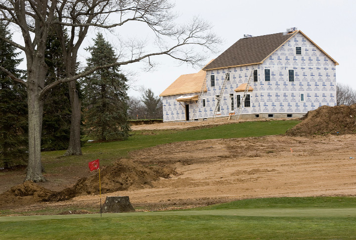 A house being constructed near the new 8th hole which was formerly the 17th at North Ridge Golf Club on Welch Road in Southington, Wednesday, April 6, 2016. The nine holes and clubhouse at North Ridge Golf Course will receive a redesign at the end of the season as part of a larger site redevelopment that includes nearly 100 homes.  |  Dave Zajac/Record-Journal
