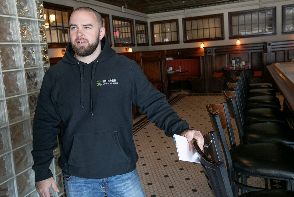 Kyle Cipully, general manager, talks Friday at the Waverly Inn, 286 Maple Ave. in Cheshire. Owners of the Waverly Inn restaurant have the historic location for sale, but said until they find the next owner, everything is business as usual. Photos by Dave Zajac, Record-Journal