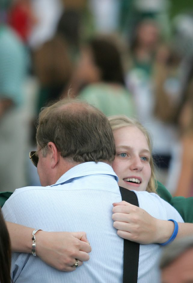 Roger Stolting hugs his daughter Amy Stolting just after graduation ceremonies. This is at the graduation ceremonies at Maloney High School in Meriden Tuesday June 12, 2006. Chris Angileri/Record-Journal.