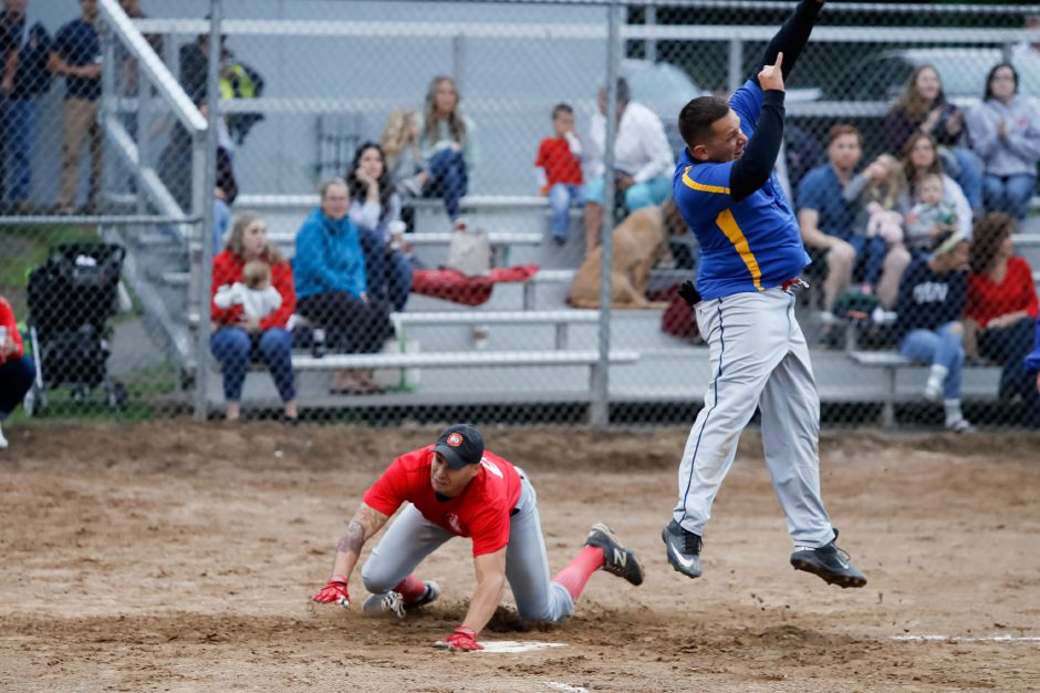 Fire's Doug Zigmonds, left, beats the throw home to Police's Mike Shedlock.