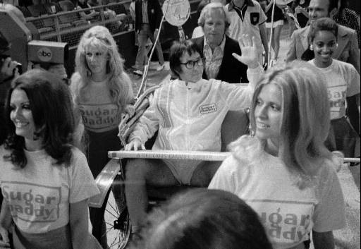 "Bobby Riggs rides in a carriage pulled by women in his grand entrance to the Astrodome in Houston, Tx., for his $100,000 winner-take-all ""Battle of the Sexes"" match against Billie Jean King, Sept. 21, 1973. (AP Photo)"