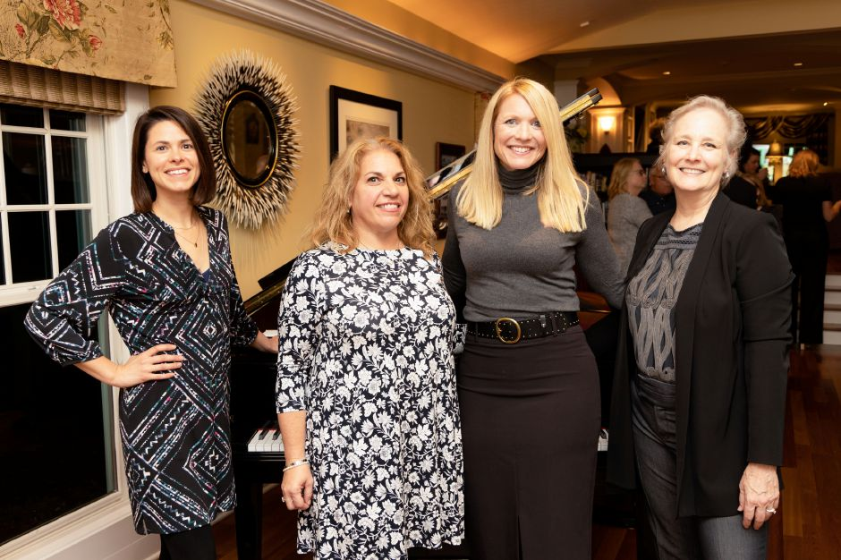 From left: Caitlin Daikus, Senior Coordinator, Health Programs for Special Olympics Connecticut, Heidi Adamski, Colleen Langlais and Jean Herzog, Senior Director, Health and Wellness for Special Olympics Connecticut.