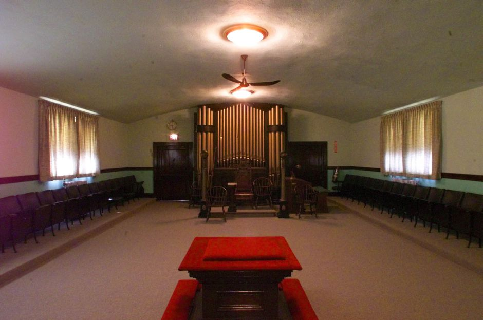 The Tower Lodge of the Masonic Temple features a gold-plated organ and other lavish trappings . Since the Lodge has opened the rooms for special events, several weddings have taken place there. Masons lead bride and groom through this room to the red altar (in the foreground) where they exchange their vows, May 1999.
