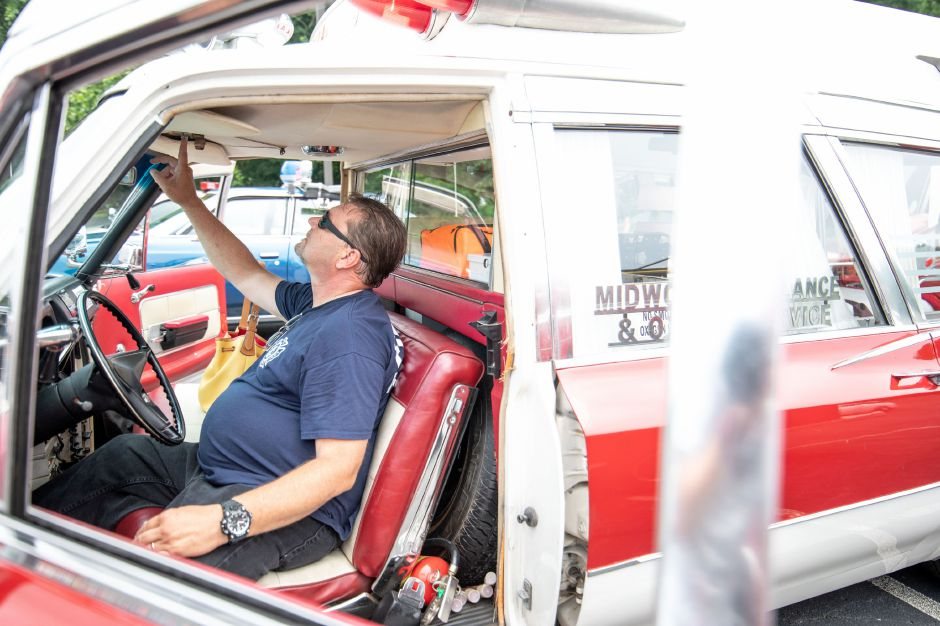 Brian Sullivan, of Wallingford, turns the activates the siren and lights on his restored ambulance at the Wallingford Fire Department