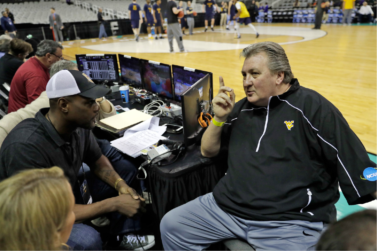 West Virginia head coach Bob Huggins, right, talks with television analyst Chris Webber, left, during practice Wednesday, March 22, 2017, in San Jose, Calif., in preparation for an NCAA Tournament college basketball regional semifinal game. West Virginia faces Gonzaga on Thursday. (AP Photo/Marcio Jose Sanchez)