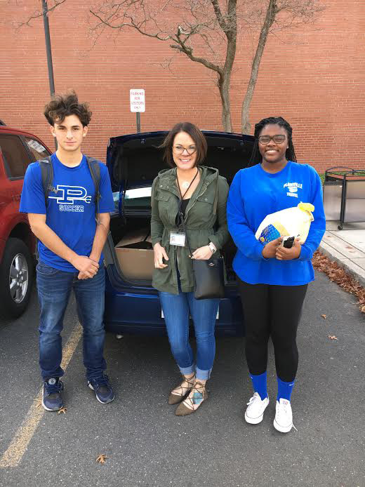 During October and November, Plainville High School DECA members collected and donated foo for the annual Adopt-A-Family event. Their partnership with the new Britain office of the State Department of Children and Families provided the opportunity to donated holiday food baskets for five families from the Plainville area.