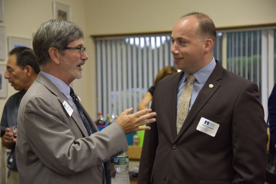 President of the Midstate Chamber of Commerce Sean W. Moore speaks with Meriden Mayor Kevin Scarpati at the United Way