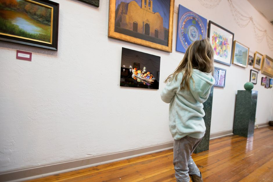 Ainsley Ulstad 4 of Middletown stops to look at the art on display Saturday during Gallery 53