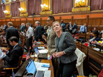 Rep. Christine Palm checking the vote in the House Wednesday. | Kathleen Megan, The Connecticut Mirror