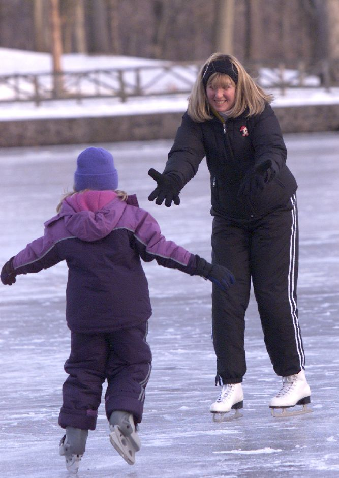 Kimberly Wheeler, right, coaches along her 8 year old niece Melanie Chasse while they skate at Hubbard Park in Meriden Friday afternoon January 24, 2003.