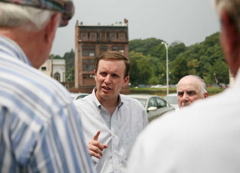 Congressman Chris Murphy, D-5th District, toured flood prone areas of the city Thursday and announced that the U.S. House of Representatives has approved a $650,000 federal grant to aid in the re-design of the Columbus Avenue bridge. The appropriation must still be approved by the U.S. Senate before President Obama can sign it into law. (Dave Moran/Record-Journal)