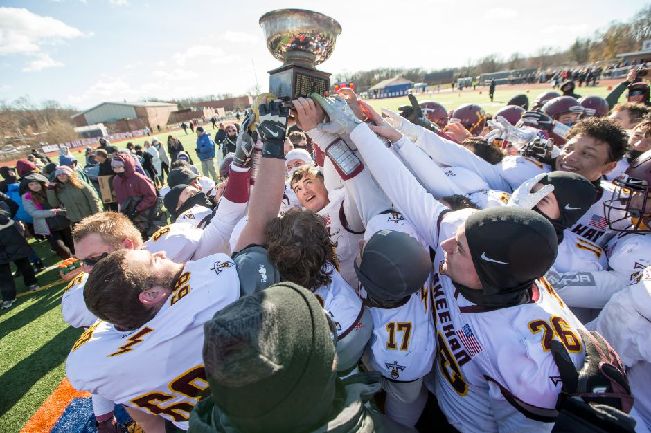 Sheehan Titans raise the Carini Bowl trophy for the seventh straight time Thursday during the 47th Annual Carini Bowl at Fitzgerald Field on the campus of Lyman Hall High School in Wallingford November 22, 2018 | Justin Weekes / Special to the Record-Journal
